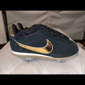 Black and gold Nikes size 6 Women